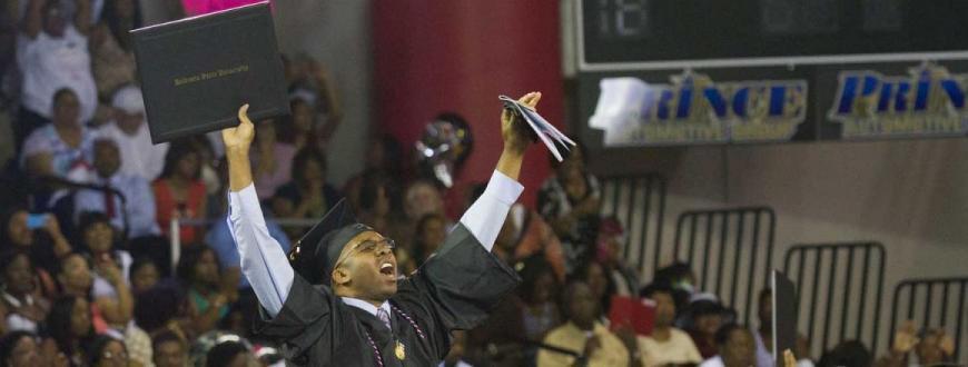 Student celebrating at Valdosta State University Graduation